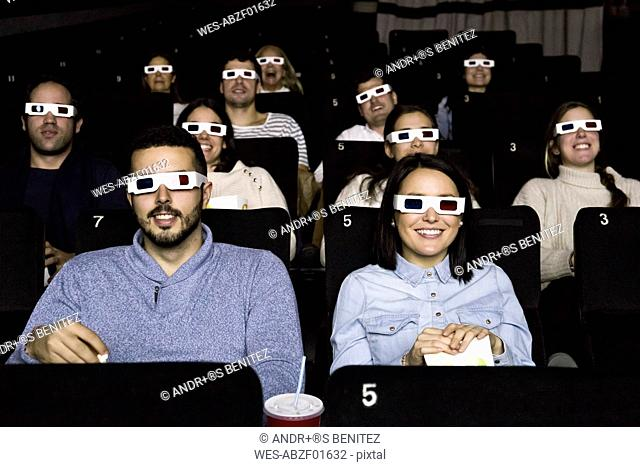 People with 3d glasses watching a movie in a cinema