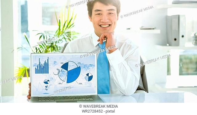 Businessman with laptop displaying graph charts on screen