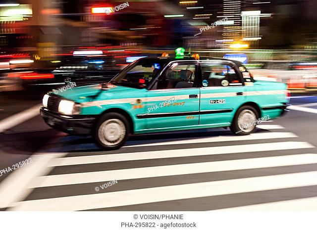 Taxicab in the streets of Tokyo, Japan