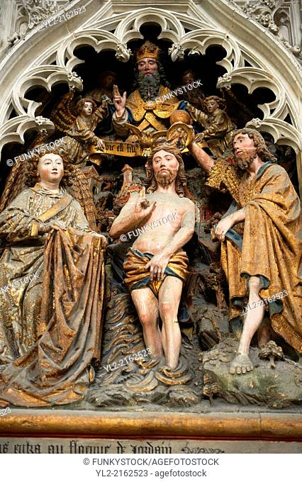 Gothic sculptures depicting John The Baptist baptsisng Christ. Cathedral of Notre-Dame, Amiens, France