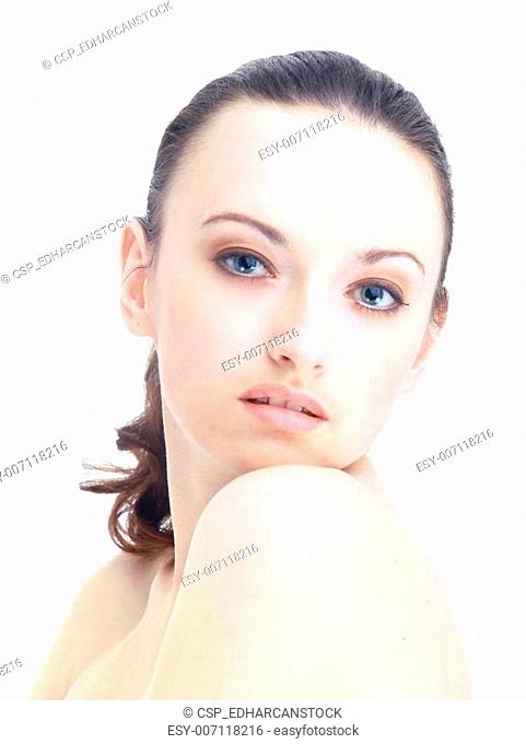 Beautiful young female face with a wellness complexion - isolated on white