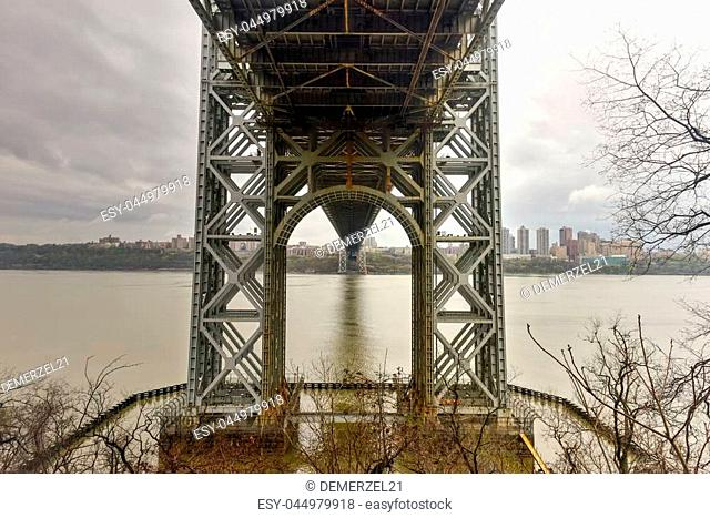 Underside of the George Washington Bridge crossing the Hudson River on a overcast cloudy day from Fort Lee, New Jersey