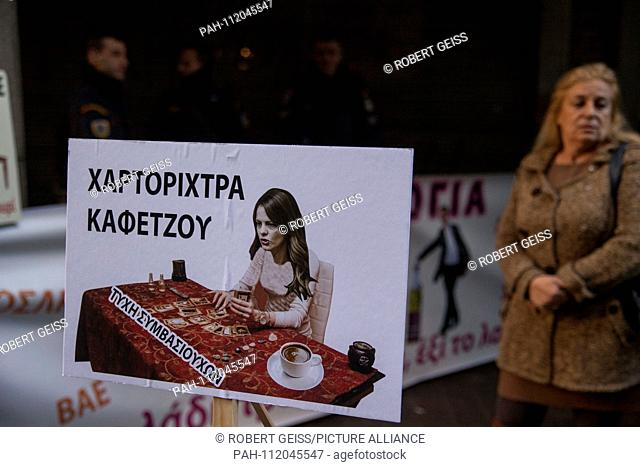 """Employee of public hospitals while protesting against possible layoffs. Shield """"""""Fortune Teller Effie Achtsioglou (Minister of Labor)"""""""". 22.11"""