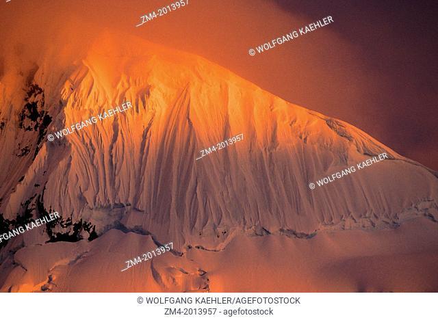 ANTARCTIC PENINSULA AREA, MIDNIGHT SUNLIGHT ON MOUNTAIN