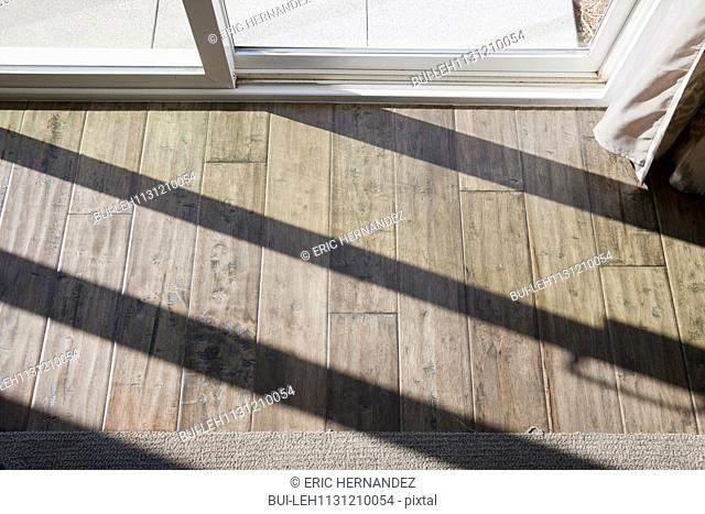Detail shot of wooden floor with sunlight at home