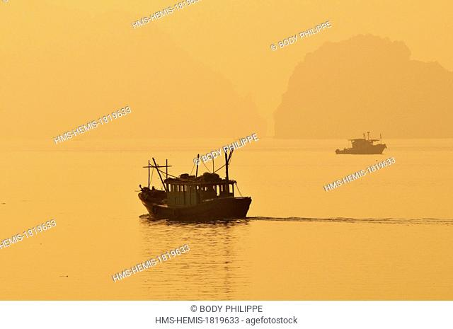 Vietnam, Quang Ninh Province, Halong Bay listed as World Heritage by UNESCO, fishing boat in the bay