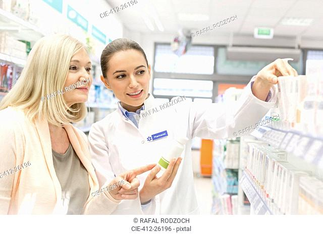 Pharmacist recommending products to customer in pharmacy