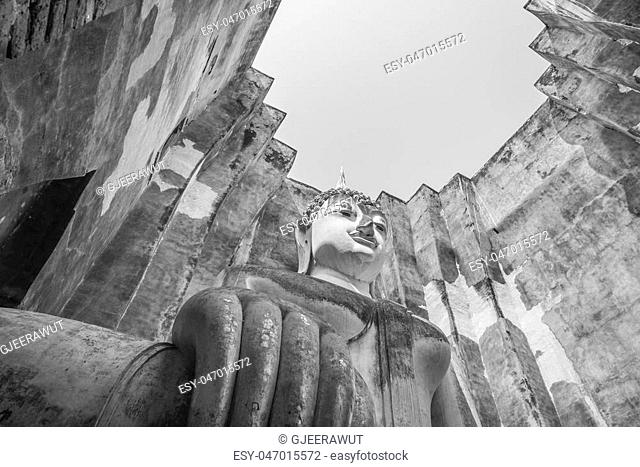 Black and white view of Old sitting buddha statue in the ancient temple Thailand
