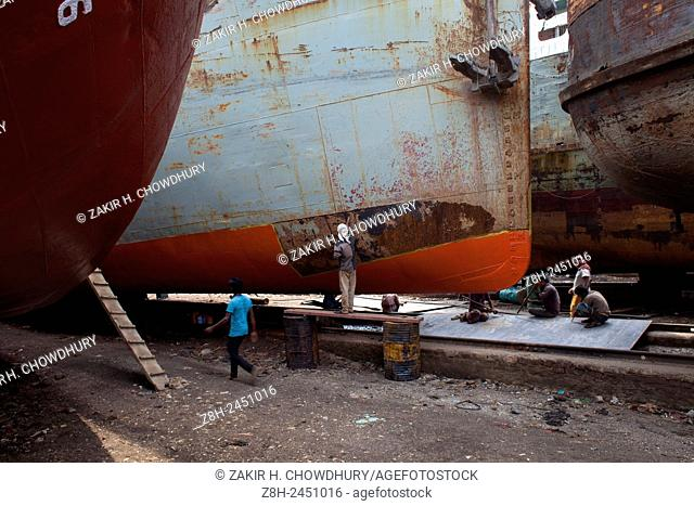 DHAKA, BANGLADESH - 12th June : Shipyard workers near the Buriganga River in Dhaka on 12th June 2015. . There are more than 35 shipyards in Old Dhakas...