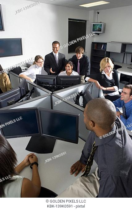 Group of young workers in office having meeting