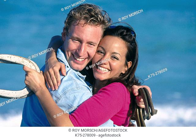 couple hugging in the middle of a horseshoe game
