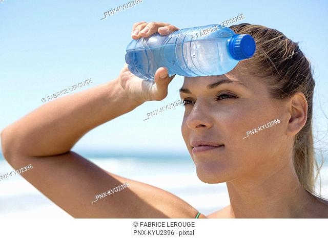 Close-up of a woman with a water bottle