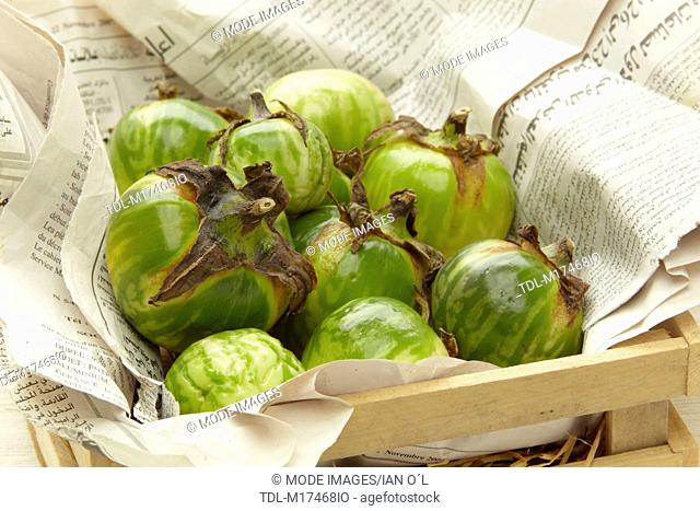 Green squashes in a wooden box