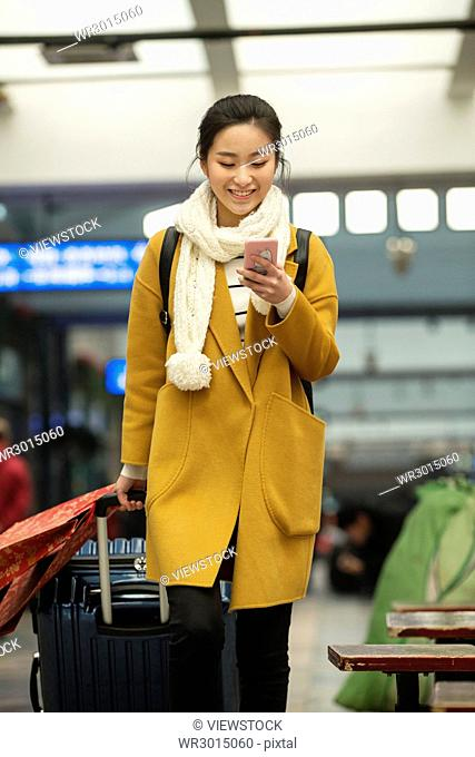 The young woman waiting for the bus at the station