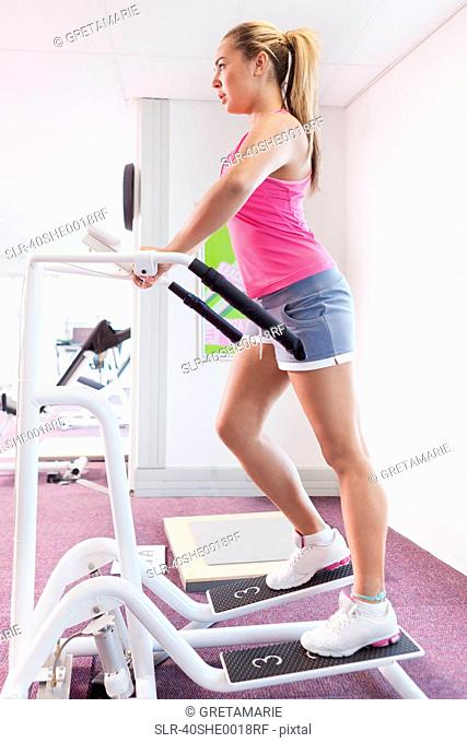 Girl exercising in gym