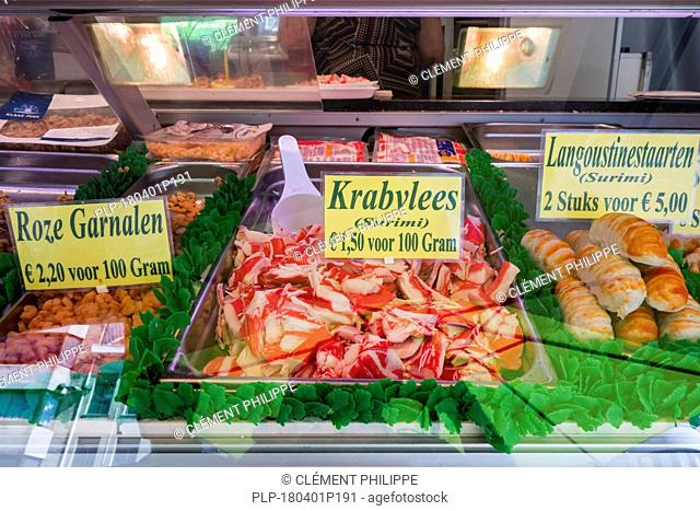 Counter with fresh seafood and surimi on display at fish stall along the Visserskaai in the city Ostend / Oostende, Belgium