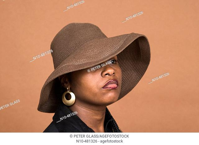 Young black woman, wearing a hat, posing