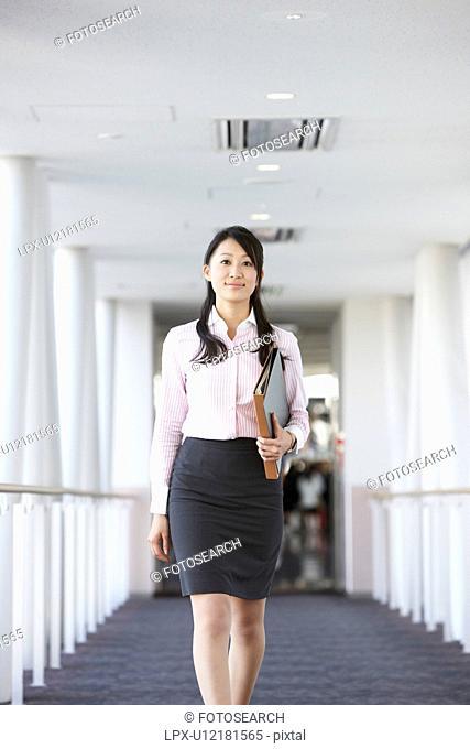 Businesswoman Walking in Corridor
