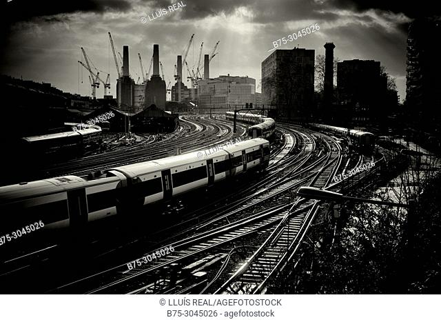 Train station with buildings in background, Battersea Power Estation. Vitoria Estation, London, England