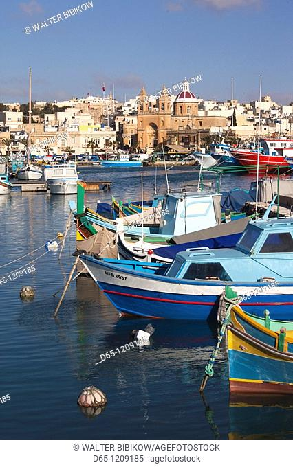 Malta, Southeast, Marsaxlokk, harbor and traditional Luzzu fishing boats