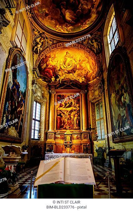 Bible on pedestal in ornate church