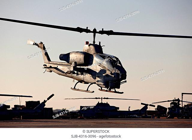 A U.S. Marine Corps AH-1W Super Cobra launches from Camp Bastion, Helmand Province, southern Afghanistan