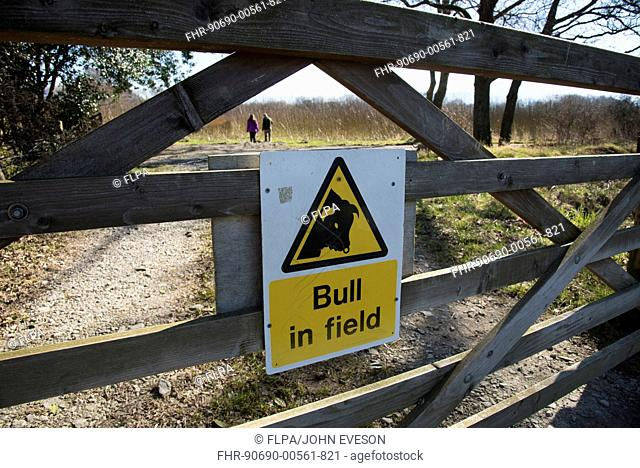 'Bull in field' sign on wooden gate, Keswick, Lake District, Cumbria, England, March