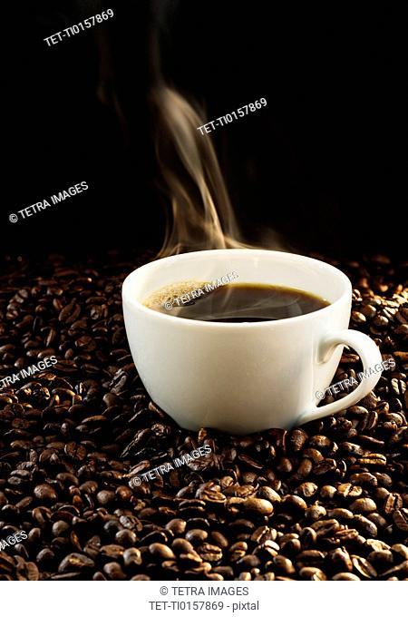 Hot coffee and coffee beans, studio shot