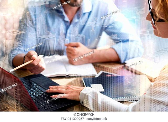 Keep work going. The focus being on the hands of a charming young woman clicking a space button to open a new slide of the presentation while discussing it with...