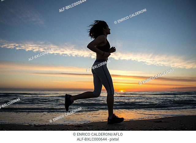 Young Girl Running On The Beach