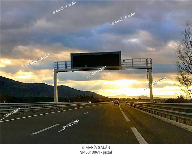 Highway at dusk. Segovia province, Castilla Leon, Spain