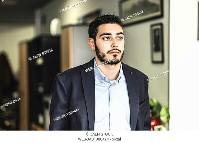 Thoughtful young man in office