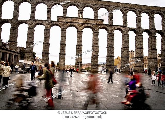 people in Roman aqueduct  Segovia  Spain