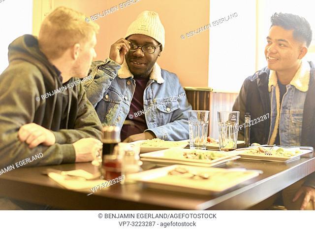 friends in restaurant, in Munich, Germany
