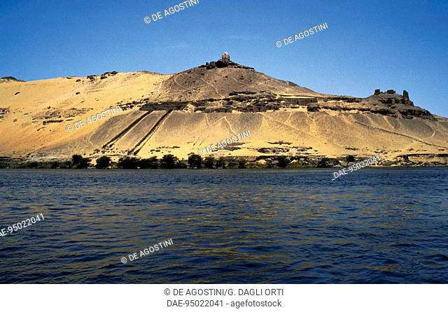 View of Qubbet el-Hawa with the underground tombs of the princes of Elephantine, monastery of St. Simeon, west bank of the Nile at Aswan