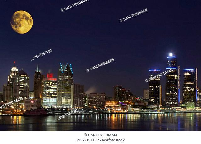 Moon above the skyline of Detroit, Michigan, USA. Detroit's population has sunk to 700,000 and the city contains several tracts of abandoned buildings