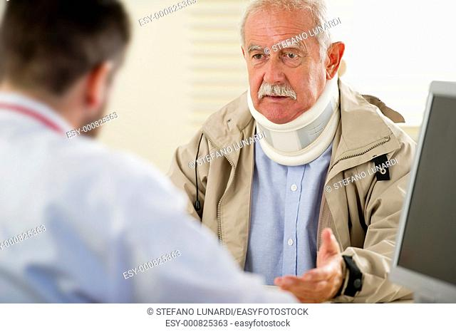 Senior man at the doctor, selective focus