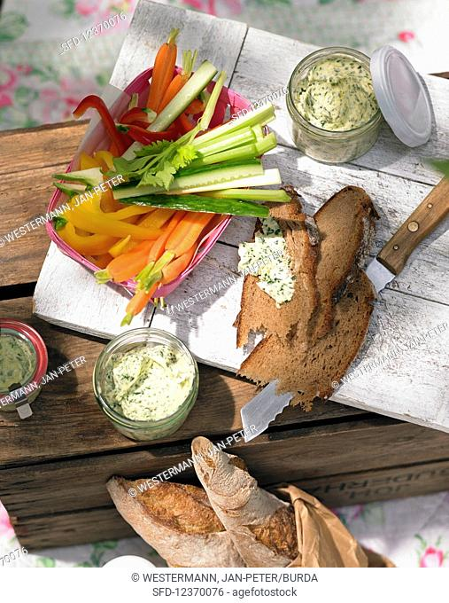 Vegetable sticks with bread and herb butter for summer picnic
