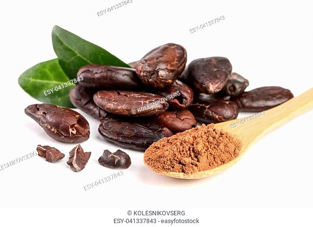 peeled cocoa bean with leaf and cocoa powder in wooden spoon isolated on white background