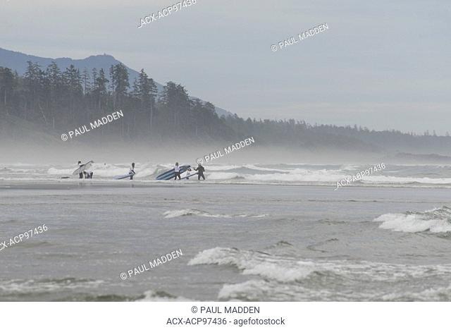 Surfing at long beach near Tofino, BC, Canada