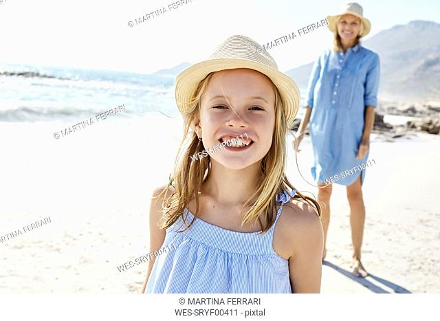 Mother and daughter having fun in the beach