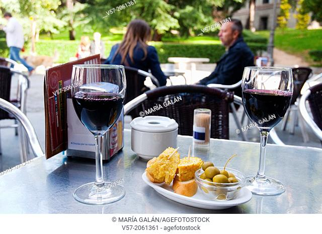 Two glasses of red wine with typical tapa in a terrace. Madrid, Spain