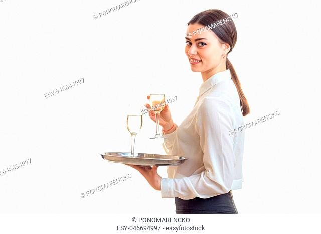 lovely young waitress in uniform with trey isolated on white background