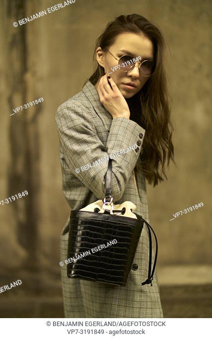 Fashionable woman on the street. Munich, Bavaria, Germany