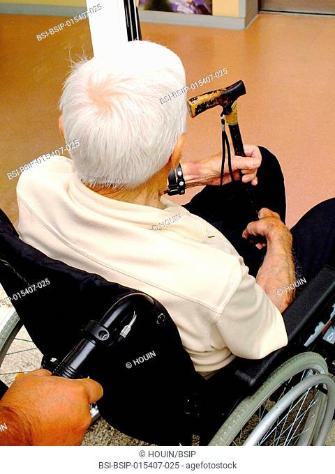 A centenarian going into a hospital