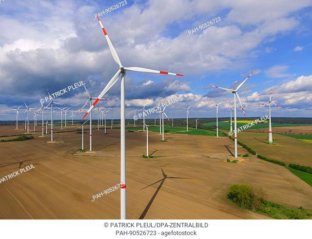 Clouds hang in the sky over a wind farm in Jacobsdorf in the state of Brandenburg, Germany, 9 May 2017. Photo: Patrick Pleul/dpa-Zentralbild/ZB   usage...
