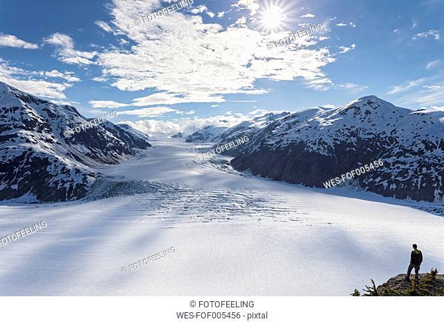 Border region Alaska-British Columbia, Man looking at Salmon Glacier