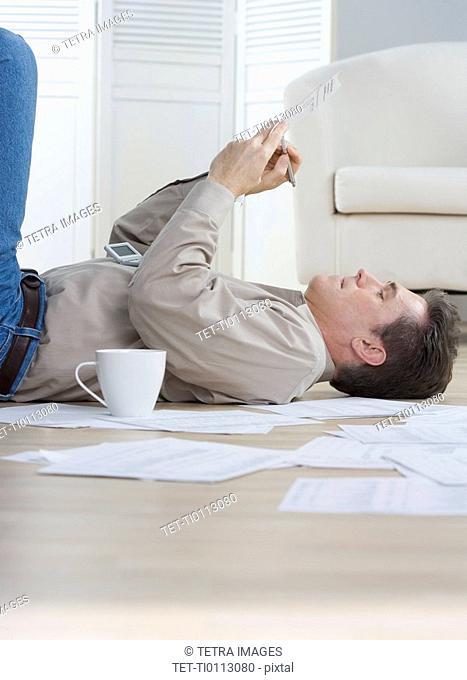 Man writing while lying on floor