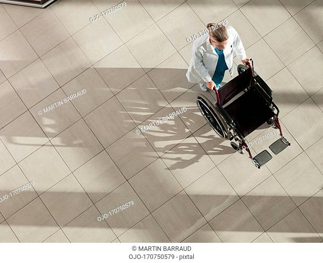 Doctor pushing wheelchair