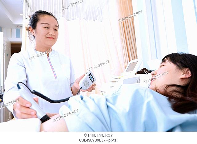 Sonographer giving pregnant patient ultrasound scan